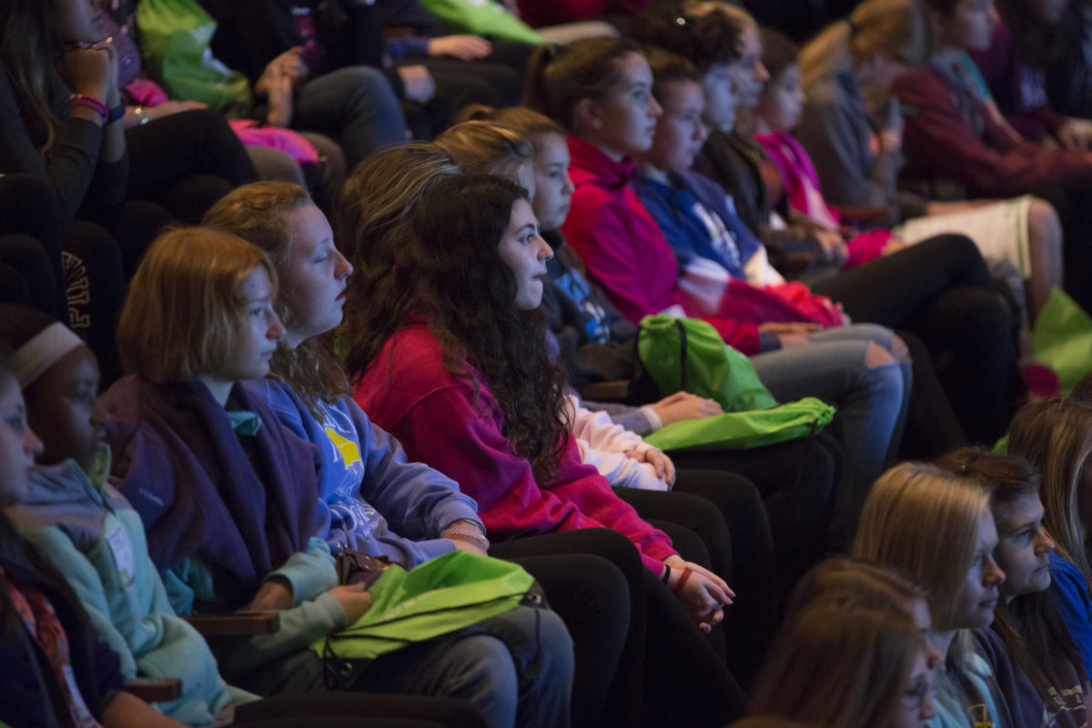 Audience of seventh- and eighth-grade girls listen to an Expanding Your Horizons speaker in 2016.