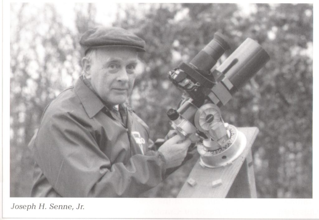 Dr. Joseph H. Senne Jr. with telescope