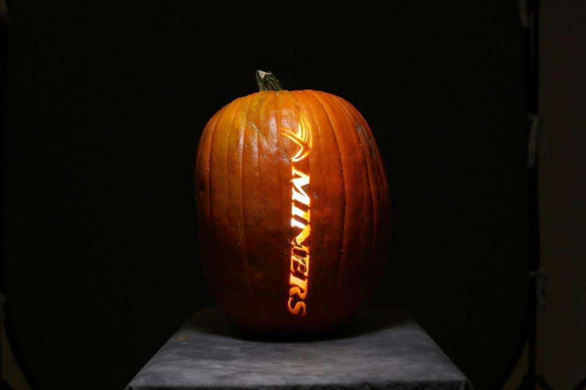 Miner-themed carved pumpkin