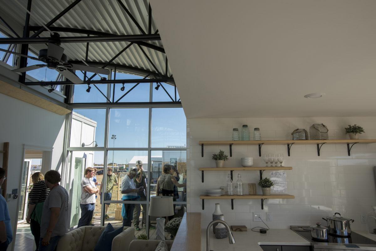 Solar Decathlon visitors tour S&T's solar house.