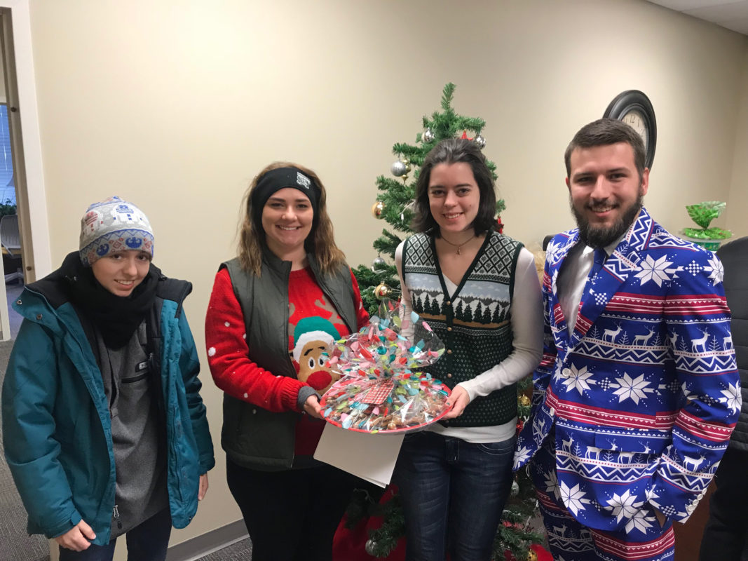 HR student workers in holiday outfits and with cookies