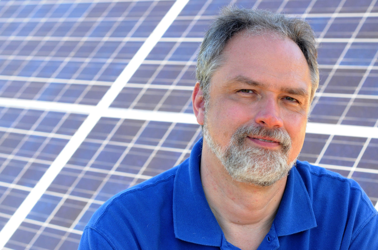 Bruce McMillin photo with solar panels