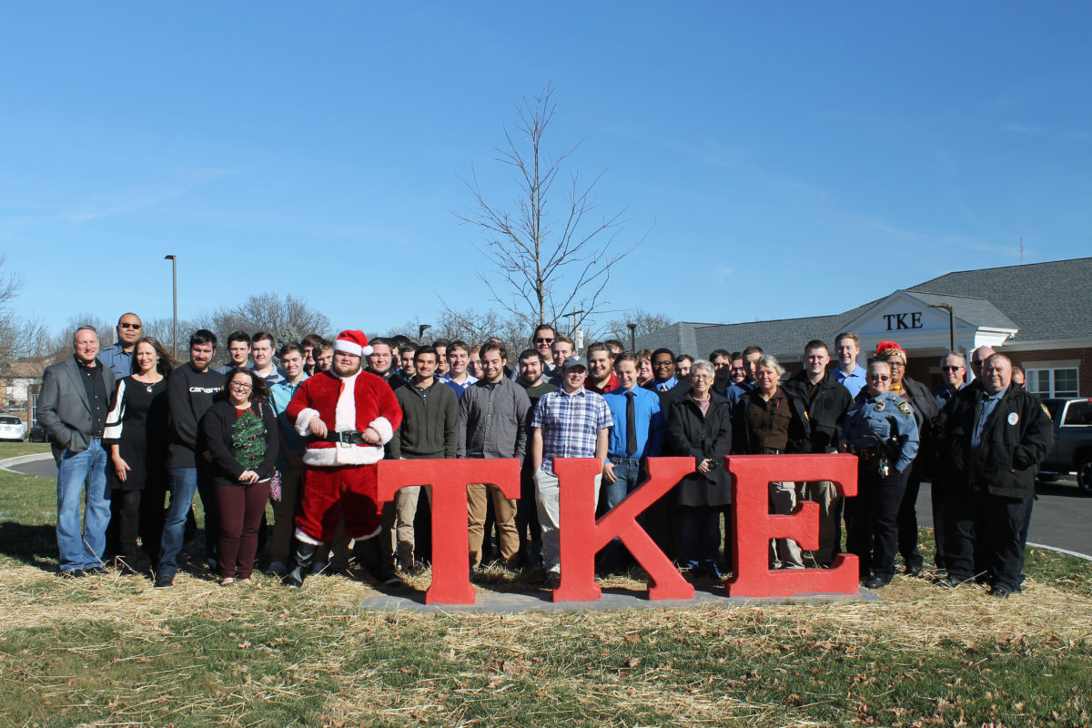 Fraternity brothers and police outside TKE house
