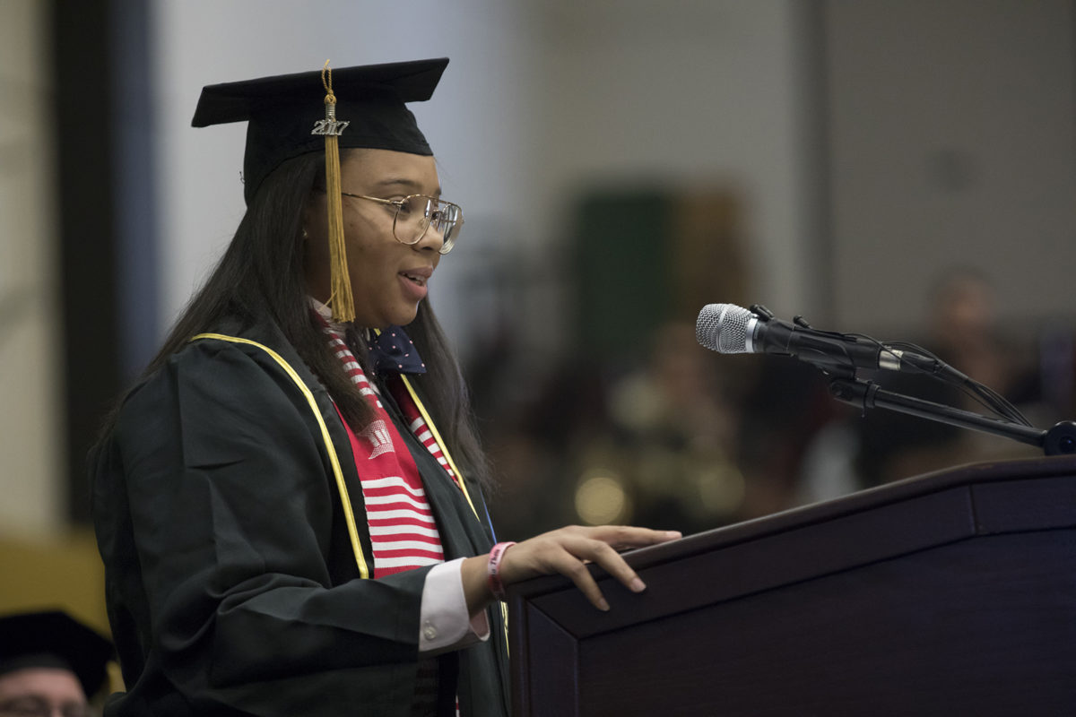 Dajae Williams speaks to her graduating class during commencement on Dec. 16, 2017.