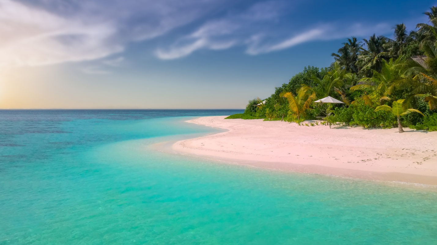 beach with white sand and blue water