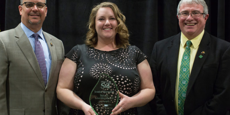 Experiential learning, service awards go to four
