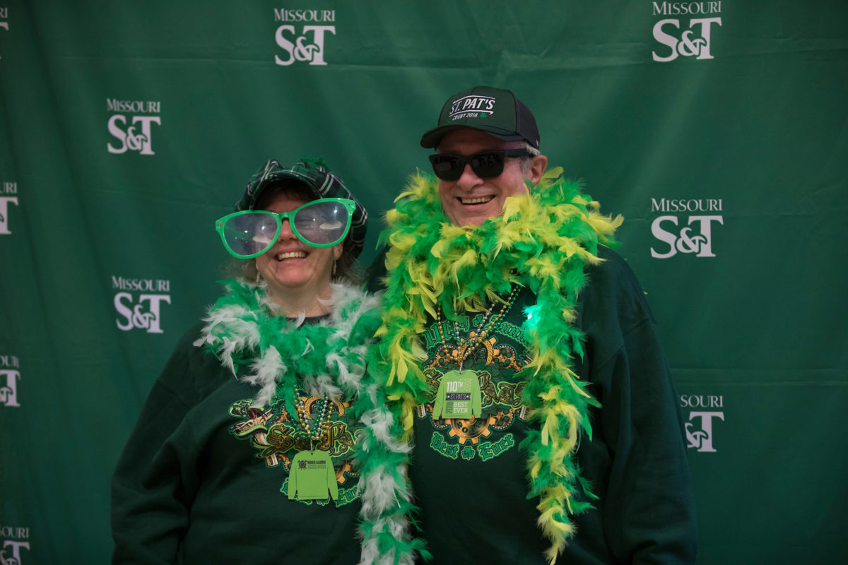 Christopher Maples and Sara Marcus dressed in green and green props at the photo booth at the St. Patrick's Day breakfast on March 17, 2018.