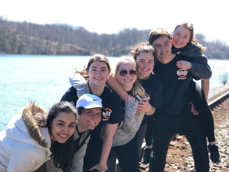 Seven students pose for a photo during their alternative spring break.