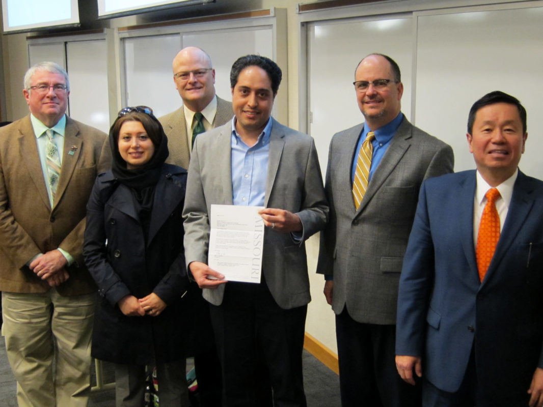 Nicolas Libre receives the President's Award for Innovative Teaching at a faculty meeting March 22.