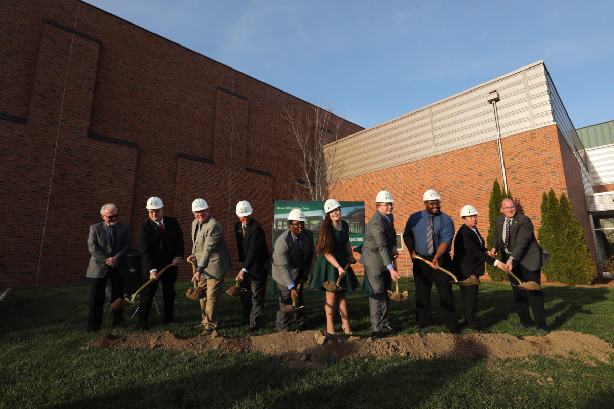 Students and university leaders break ground on April 12 for the student fitness center expansion.