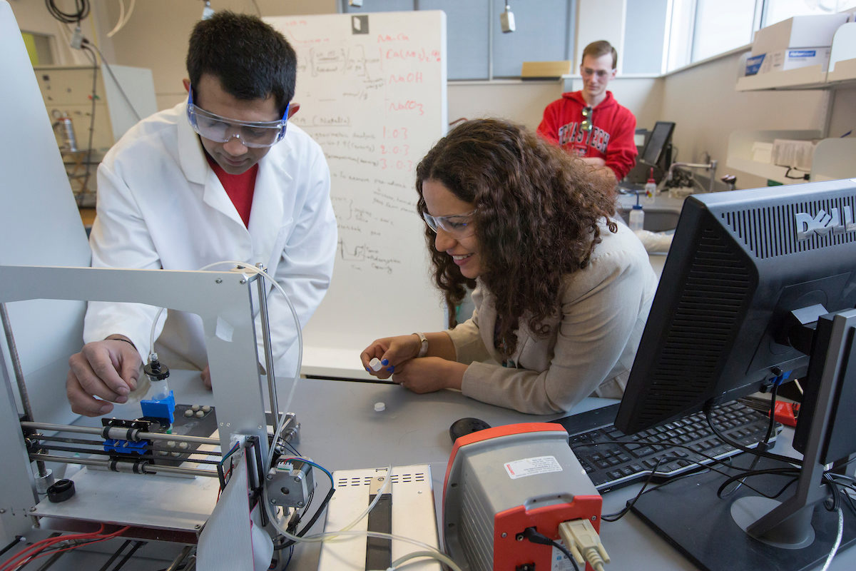 Dr. Fateme Rezaei and student Harshul Thakkar work together in Bertelsmeyer Hall on developing technology to help keep astronauts safe from carbon dioxide buildup.