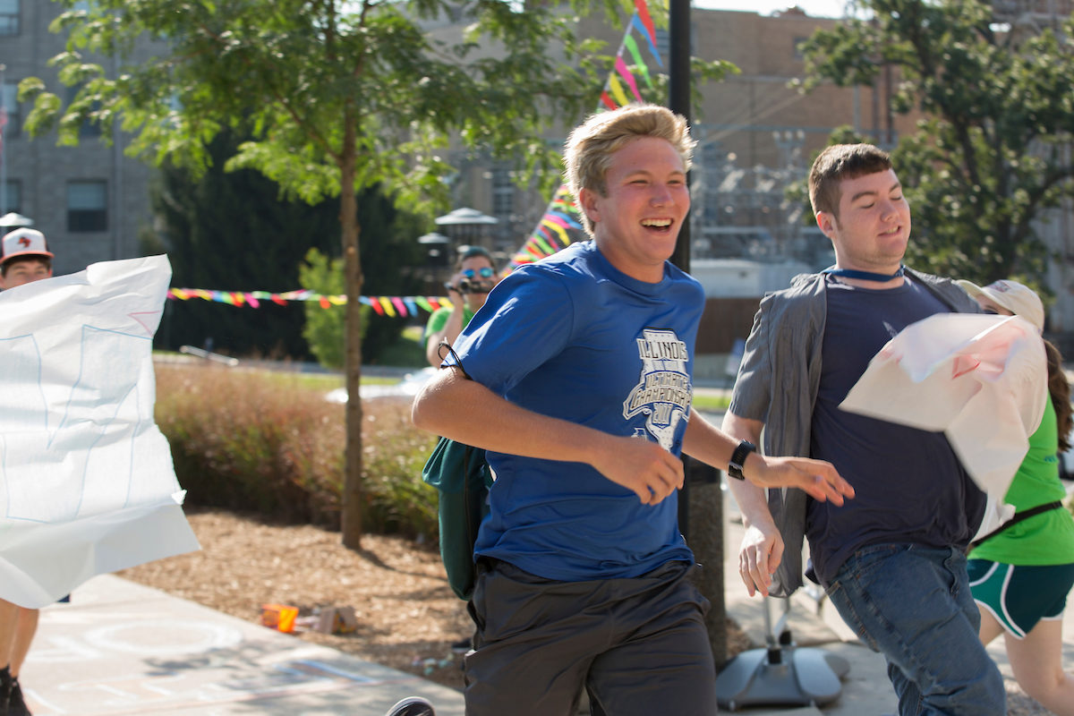 Two Project X participants running to finish line