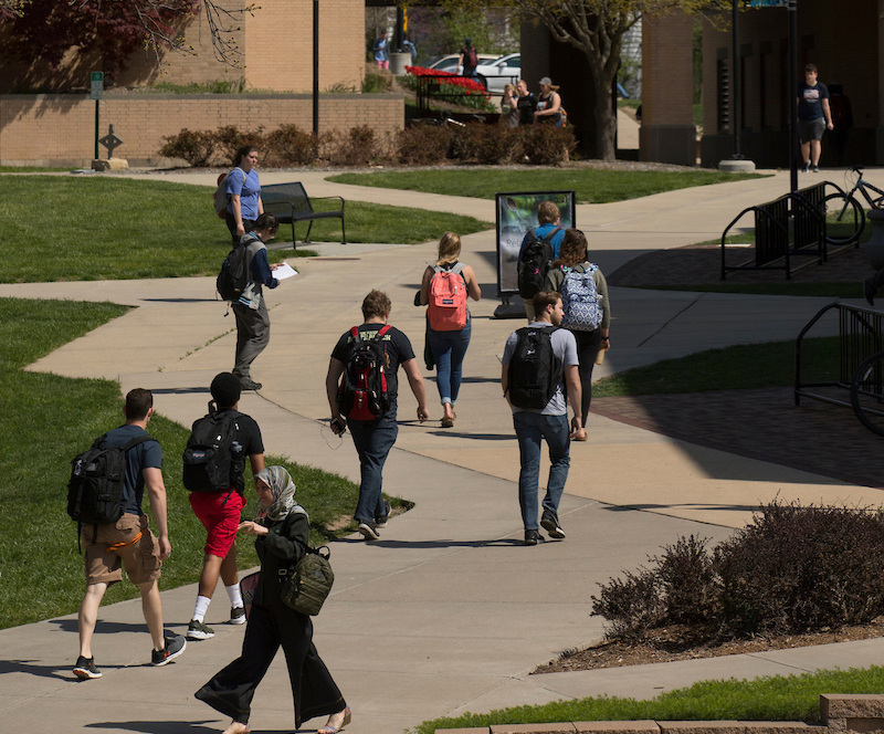Students walking on campus near Emerson Hall