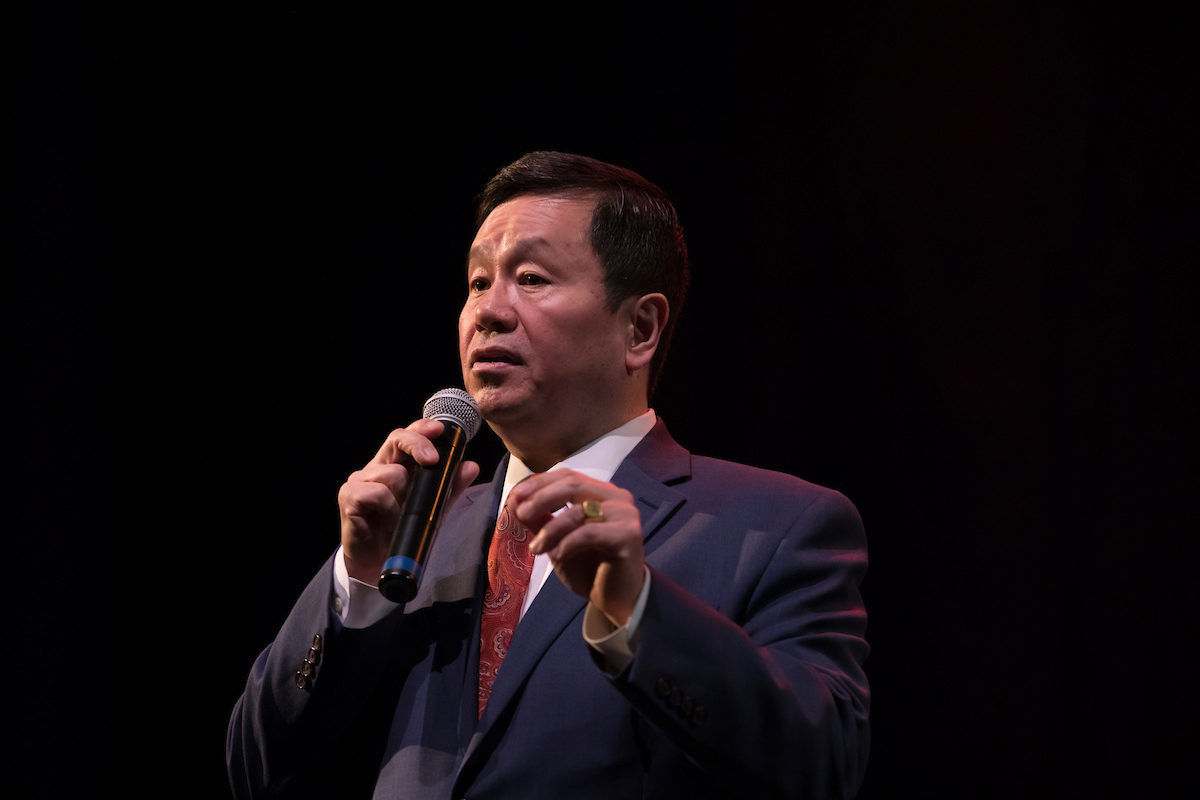 President Choi with microphone