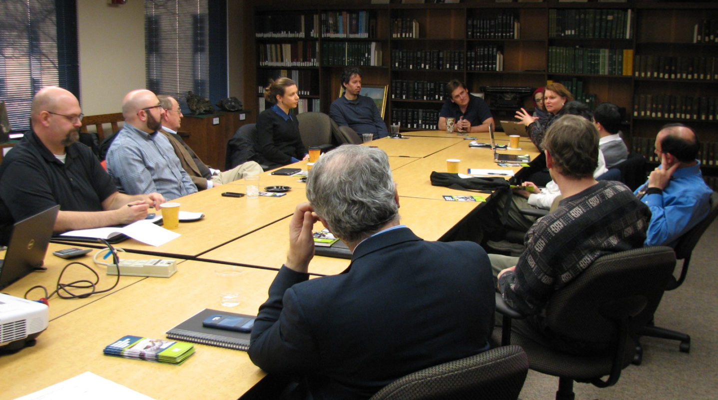Faculty discussion around table