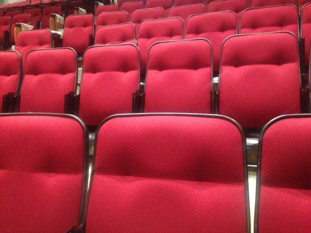 Closeup of red theater seats