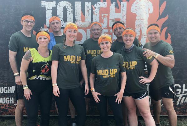 Group photo of Tough Mudder participants