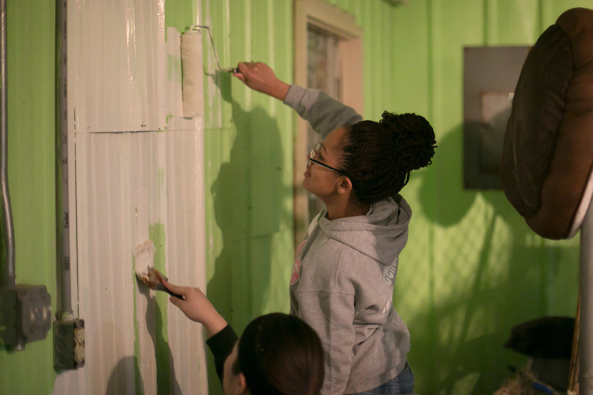 Students paint building
