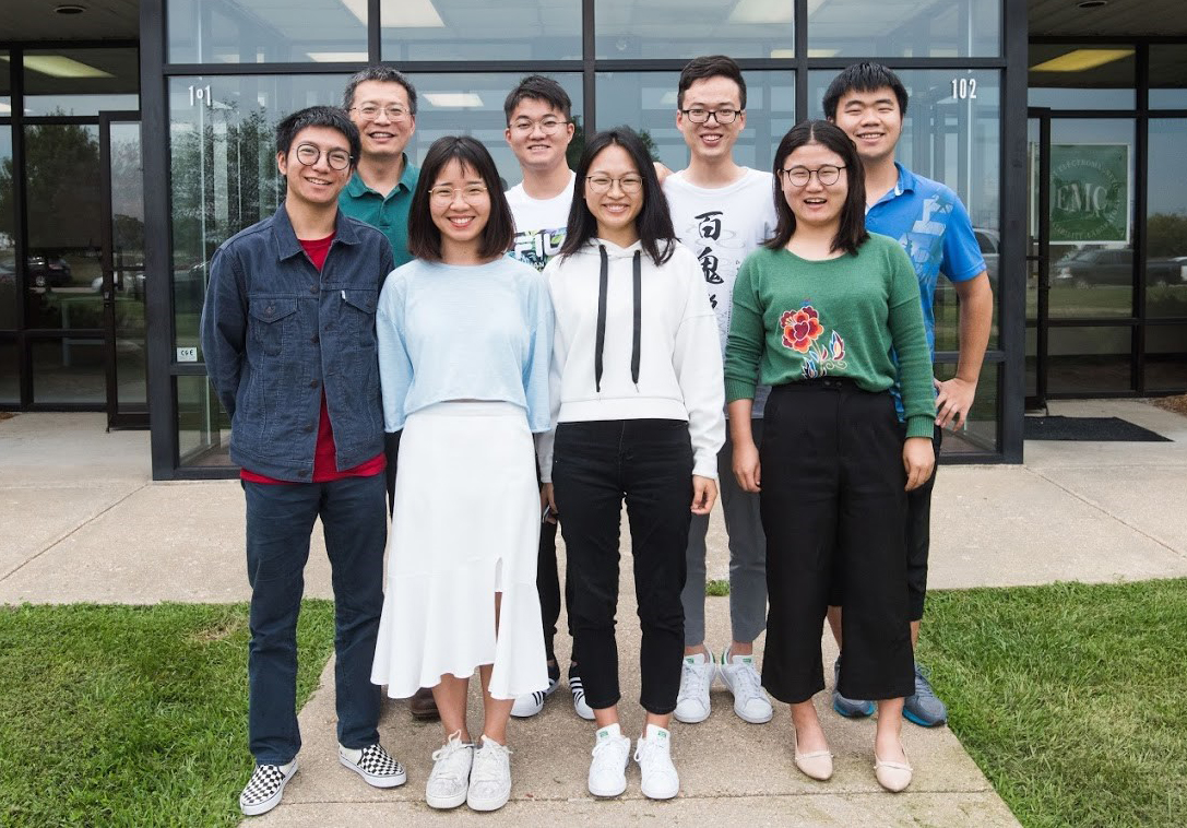 Group photo of 8 interns