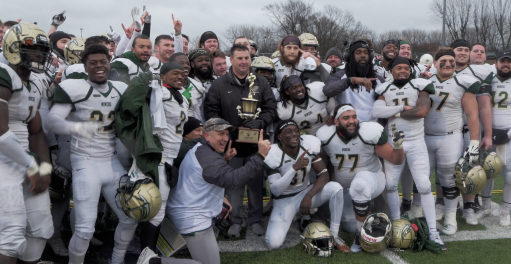 Football team and coach with trophy