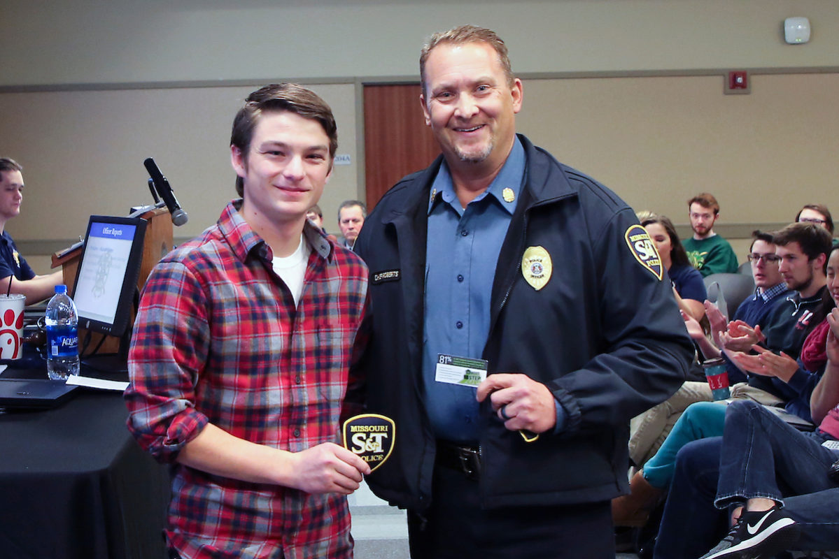 student with police chief