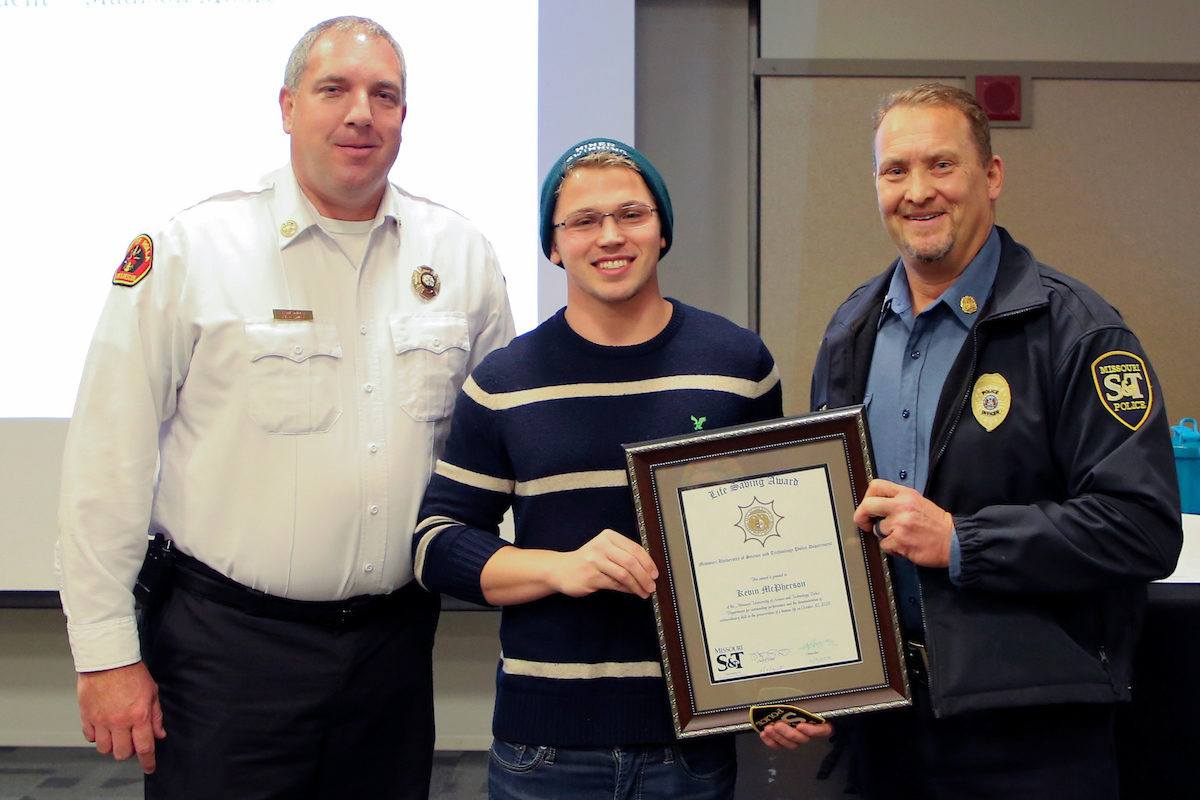 student with police chief and fire chief