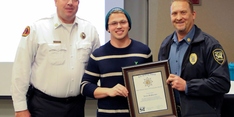 Lifesaver — Student honored for rescuing swimmer