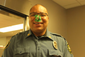 Oscar Kemp with icing on nose and face