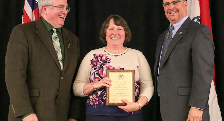 Surprise! Eight faculty receive Sustained Excellence in Teaching Award