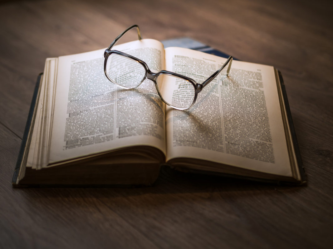 Open book with eye glasses