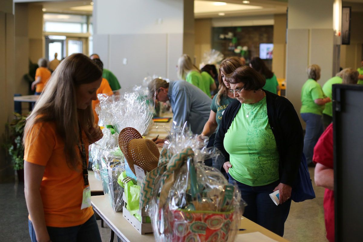 Employees look at gift baskets