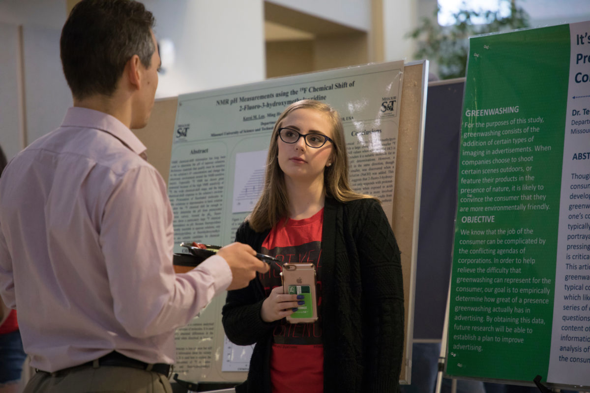 Student near research posters