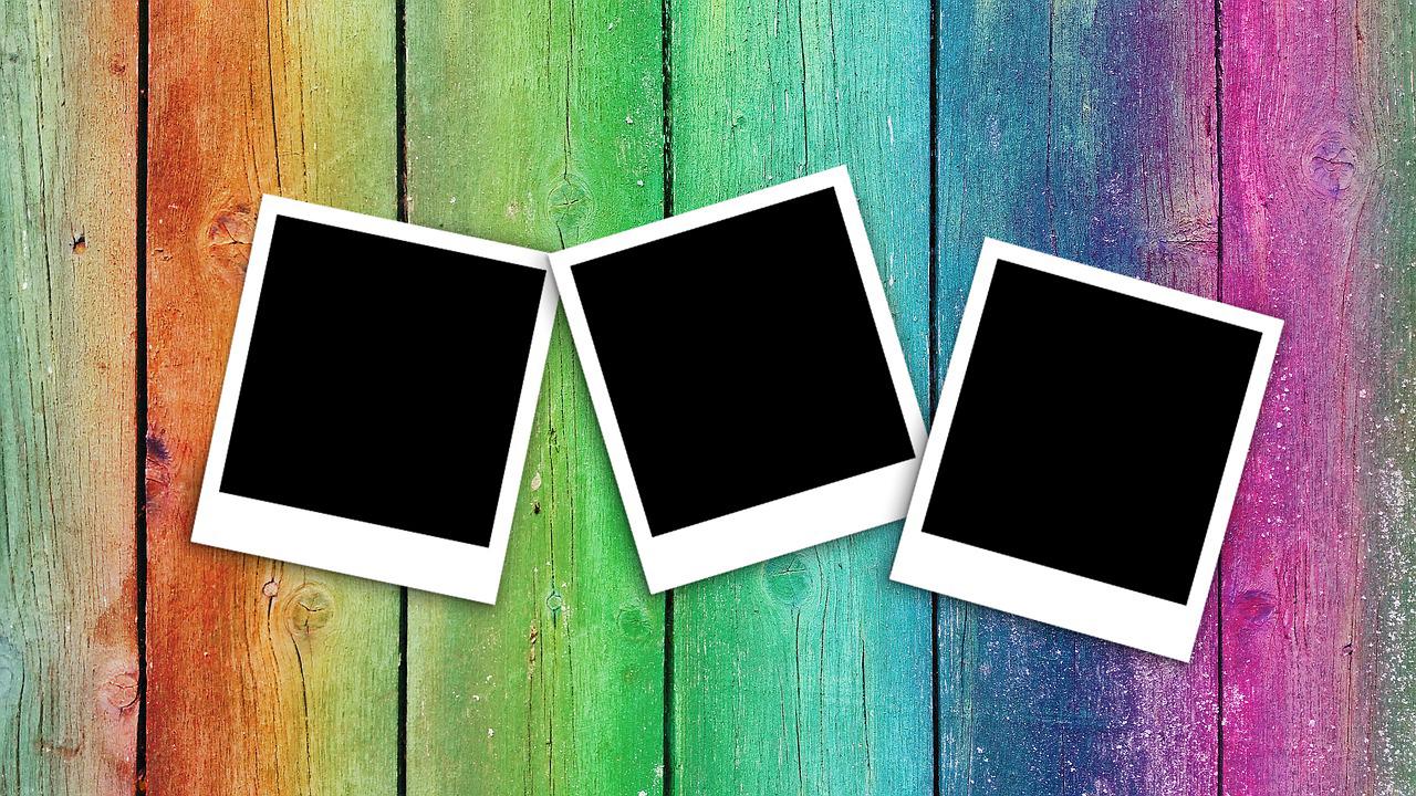 Blank Polaroids on wood backdrop