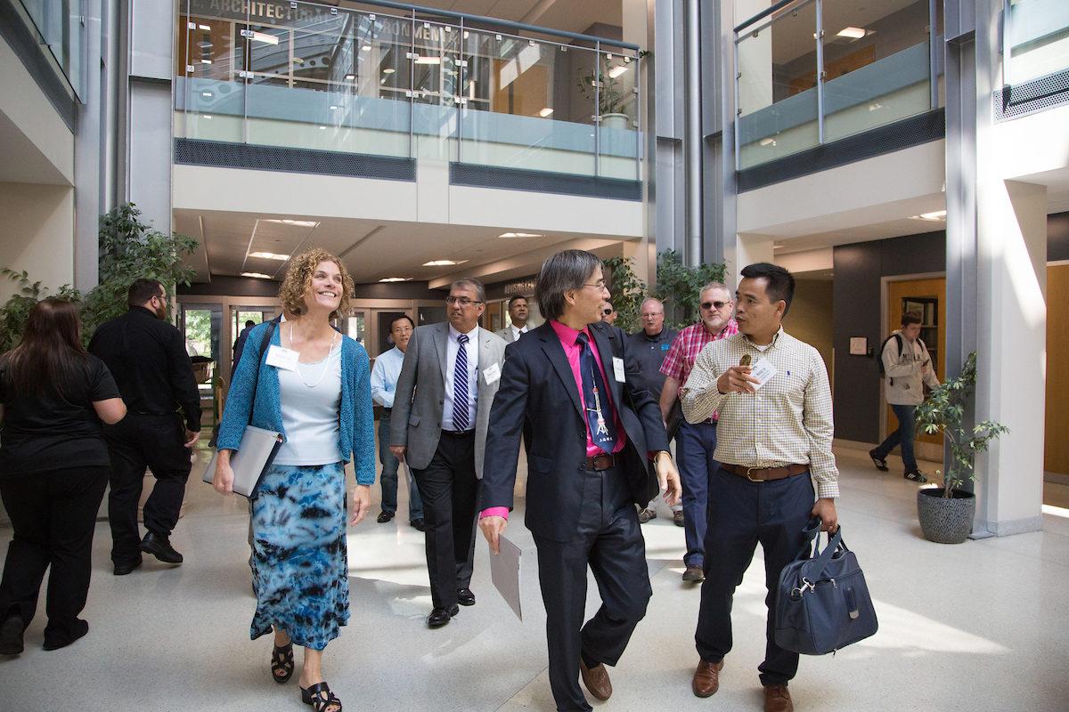 Faculty walking in lobby of Butler-Carlton Civil Engineering Hall