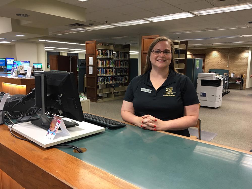 Amanda Sauerwein at library desk