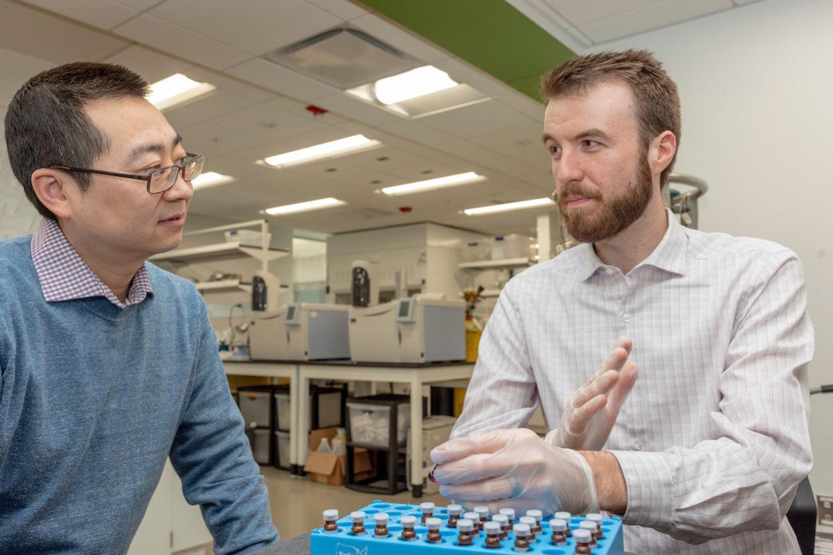 Liu and Burton in lab