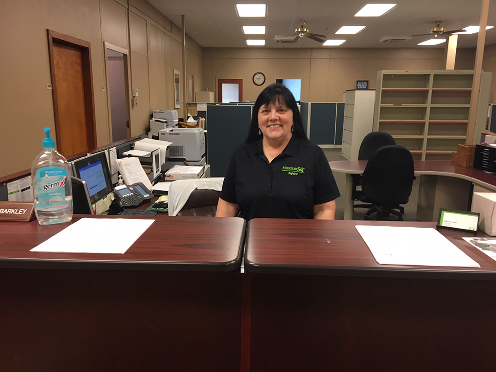 Mary Lou Barkley at front desk