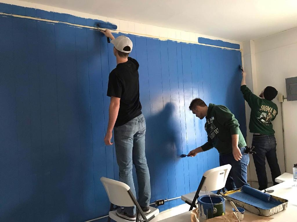 3 students paint