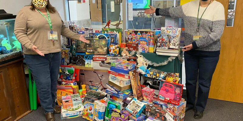 Employees donate hundreds of toys to G.R.A.C.E.