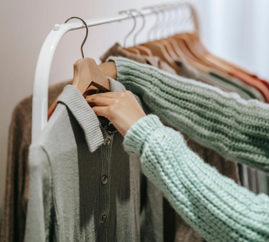 choosing clothing off rack