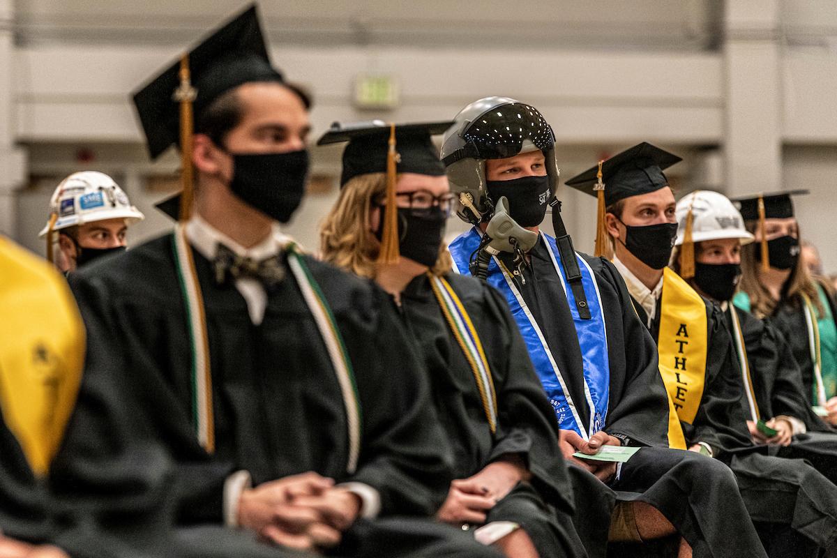 Graduates with masks